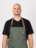 Chef´s black jacket detail with chef green apron
