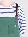 Green barista apron detail