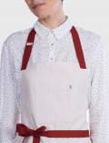 White linen apron detail