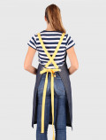 Blue bib apron with yellow ribbons