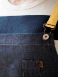 Denim bib apron with yellow ribbons detail