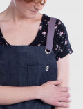 Cross back aprons for cosmetology uniforms detail
