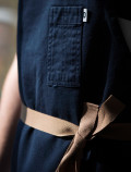 Dark blue waiter apron detail
