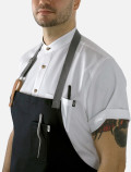White chef's shirt detail with apron
